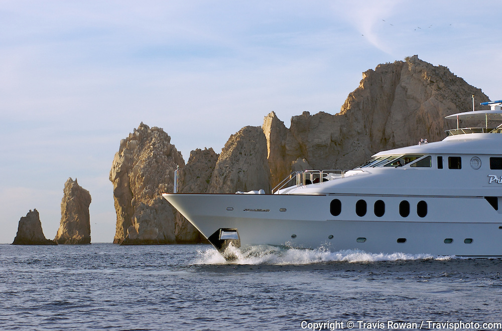 "The large luxury private yacht ""Primadonna"" cruising near lands end in Cabo San Lucas, Mexico."