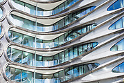 Elegant glass and steel high rise condo apartment block 520 West 28th Street designed by famous architect Zaha Hadid by The High Line, west side Manhattan, New York
