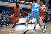 Cal State Fullerton Titans guard Brandon Kamga (1) looks to drive against San Diego Toreros forward Alex Floresca (15) during an NCAA basketball game, Wednesday, Dec. 11, 2019, in Fullerton, Calif. San Diego defeated CSUF 66-54. (Jon Endow/Image of Sport)