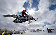 Jake Scott gets airborne on the course during a World Cup race at the AMSOIL Snocross Championships in Lake Geneva, Wi., Sunday, March 17, 2013. Jeffrey Phelps for the New York Times.