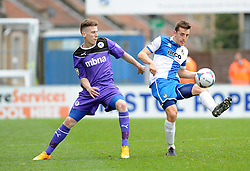 Bristol Rovers' Tom Lockyer is challenged by Chester's Tom Peers - Photo mandatory by-line: Neil Brookman/JMP - Mobile: 07966 386802 - 03/04/2015 - SPORT - Football - Bristol - Memorial Stadium - Bristol Rovers v Chester - Vanarama Football Conference