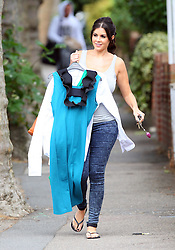 Pregnant model Imogen Thomas wearing a grey vest top and jeans picks up some dry cleaning with her boyfriend Adam Horsley in north London, UK. 14/09/2012<br />BYLINE MUST READ : JAMESY/GOTCHA IMAGES<br /><br />Copyright by © Gotcha Images Ltd. All rights reserved.<br />Usage of this image is conditional upon the acceptance <br />of Gotcha Images Ltd, terms and conditions available at<br />www.gotchaimages.com
