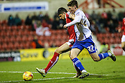 Walsall's George Evans & Swindon Town's Raphael Rossi Branco tussle for the ball during the Sky Bet League 1 match between Swindon Town and Walsall at the County Ground, Swindon, England on 24 November 2015. Photo by Shane Healey.
