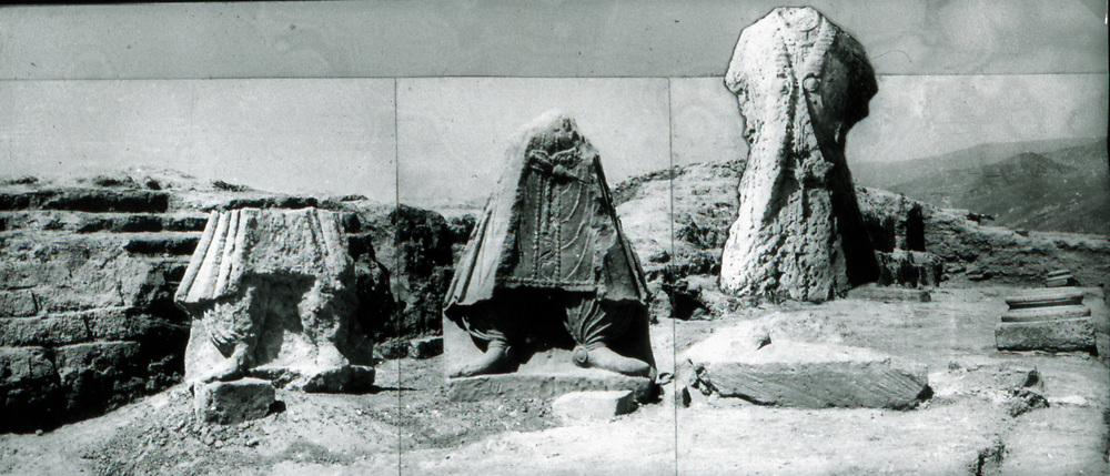 Only three fragmentary statues remained in a recognizable form. The central figure here has been identified as King Kanishka because analogous features appear on King Kanishka's gold coins. <br /> Photo: Gerard Fussman, DAFA