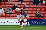 James O'Connor beats Andy Williams to the header during the Sky Bet League 1 match between Walsall and Doncaster Rovers at the Banks's Stadium, Walsall, England on 12 September 2015. Photo by Alan Franklin.