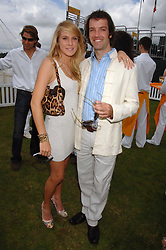 NED BROCKWAY and the HON.ELIZA PEARSON at the final of the Veuve Clicquot Gold Cup 2007 at Cowdray Park, West Sussex on 22nd July 2007.<br />