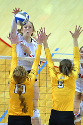 23 November 2017:  Sydney Holt attacks at Allison Ketcham and Sydney Bronner during a college women's volleyball match between the Valparaiso Crusaders and the Illinois State Redbirds in the Missouri Valley Conference Tournament at Redbird Arena in Normal IL (Photo by Alan Look)
