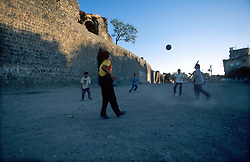 TURKEY DIYARBAKIR JUL02 - Kurdish boys play football in the dust surrounding the old city walls of Diyarbakir, the unofficial Kurdish capital on Turkish territory...jre/Photo by Jiri Rezac..© Jiri Rezac 2002..Contact: +44 (0) 7050 110 417.Mobile:  +44 (0) 7801 337 683.Office:  +44 (0) 20 8968 9635..Email:   jiri@jirirezac.com.Web:     www.jirirezac.com
