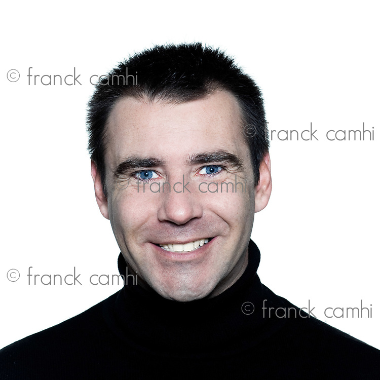 handsome caucasian man toothy white  smiling short brown with polo turtle neck hair blue eyes portrait expressing portrait on studio isolated white background