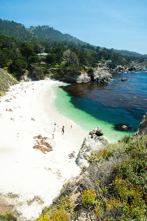 Sunbathers relax on the beach at Point Lobos State Park, near Carmel Highlands, along Highway 1, Monterey County, California.