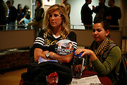 Indiana University students Caitlin O'Hara, left, and Betsy Sears react at it appears John McCain will lose the presidential election.