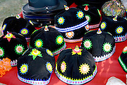 Decorative Hmong caps for sale at concession stand. Hmong Sports Festival McMurray Field St Paul Minnesota USA
