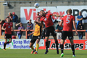 Max Muller of Morecambe jumps with Padraig Amond of Newport County during the EFL Sky Bet League 2 match between Morecambe and Newport County at the Globe Arena, Morecambe, England on 16 September 2017. Photo by Mick Haynes.