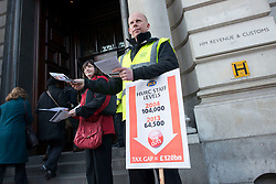 © Licensed to London News Pictures.14/01/2013. London, UK. Members of Public and Commercial Services union hand out leaflets to protest outside the HMRC headquarter ahead of an expected decision on the future of hundreds of tax offices.Photo credit : Peter Kollanyi/LNP