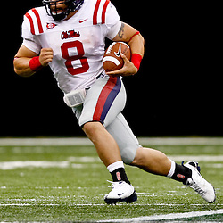 Sep 11, 2010; New Orleans, LA, USA; Mississippi Rebels quarterback Jeremiah Masoli (8) runs with the ball during a game against the Tulane Green Wave at the Louisiana Superdome. The Mississippi Rebels defeated the Tulane Green Wave 27-13.  Mandatory Credit: Derick E. Hingle