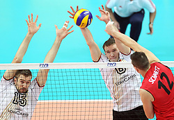 14.09.2014, Spodek, Katowice, POL, FIVB WM, Deutschland vs Kanada, 2. Runde, Gruppe F, im Bild Tim Broshog, Denys Kaliberda // during the FIVB Volleyball Men's World Championships 2nd Round Pool F Match beween Germany and Canada at the Spodek in Katowice, Poland on 2014/09/14. EXPA Pictures © 2014, PhotoCredit: EXPA/ Newspix/ Dawid Markysz<br /> <br /> *****ATTENTION - for AUT, SLO, CRO, SRB, BIH, MAZ, TUR, SUI, SWE only*****