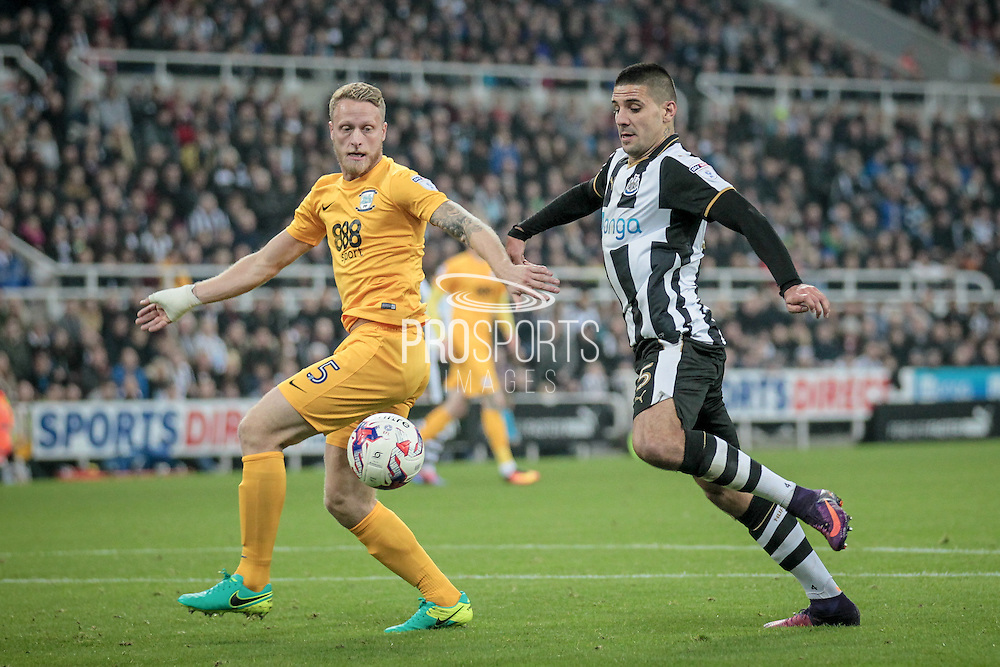 Aleksandar Mitrović (Newcastle United) goes to collect the ball, before turning inside Tom Clarke (Preston North End) and setting up the chance to score for Newcastle during the EFL Cup 4th round match between Newcastle United and Preston North End at St. James's Park, Newcastle, England on 25 October 2016. Photo by Mark P Doherty.