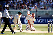 Stuart Broad looks at run out opportunity during the Magellan fourth test match between Australia v England at  the Melbourne Cricket Ground, Melbourne, Australia on 26 December 2017. Photo by Mark Witte.