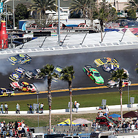 NASCAR Sprint Cup Series drivers Michael Waltrip (15), Andy Lally (71), Joe Nemechek (87) Greg Biffle (16), David Reutimann (00), JImmie Johnson (48), Mark Martin (5) and Jeff Gordon (24) are involved in a multi car crash during the Daytona 500 at Daytona International Speedway on February 20, 2011 in Daytona Beach, Florida. (AP Photo/Alex Menendez)