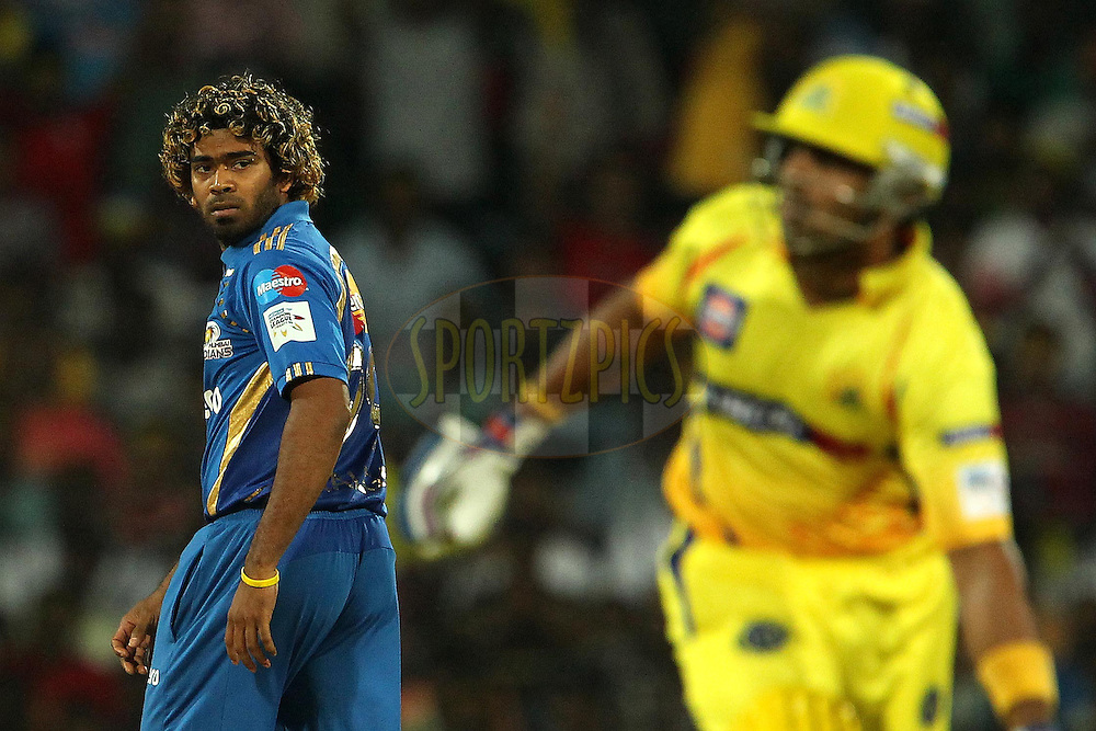 Lasith Malinga watches as Murali Vijay makes the run during match 3 of the NOKIA Champions League T20 ( CLT20 )between the Chennai Superkings and the Mumbai Indians held at the M. A. Chidambaram Stadium in Chennai , Tamil Nadu, India on the 24th September 2011..Photo by Ron Gaunt/BCCI/SPORTZPICS