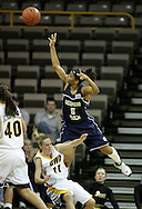 28 NOVEMBER 2007: Georgia Tech guard Jill Ingram (5) puts up a shot over Iowa guard Kristi Smith (11) in the first half of Georgia Tech's 76-57 win over Iowa in the Big Ten/ACC Challenge at Carver-Hawkeye Arena in Iowa City, Iowa on November 28, 2007.