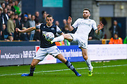 Leeds United defender Stuart Dallas (15) in action during the EFL Sky Bet Championship match between Millwall and Leeds United at The Den, London, England on 5 October 2019.