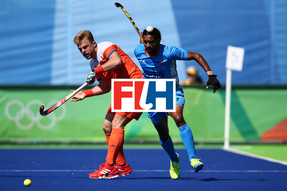 RIO DE JANEIRO, BRAZIL - AUGUST 11:  Mink van der Weerden #30  of Netherlands defends against Akashdeep Singh #27 of India during a Men's Preliminary Pool B match on Day 6 of the Rio 2016 Olympics at the Olympic Hockey Centre on August 11, 2016 in Rio de Janeiro, Brazil.  (Photo by Sean M. Haffey/Getty Images)