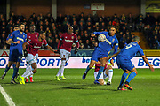 AFC Wimbledon defender Terell Thomas (6) with a shot on goal during the The FA Cup match between AFC Wimbledon and West Ham United at the Cherry Red Records Stadium, Kingston, England on 26 January 2019.