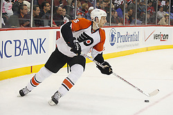 November 8, 2007; Newark, NJ, USA;  Philadelphia Flyers defenseman Braydon Coburn (5) skates the puck out of the zone during the second period of their game against the New Jersey Devils at the Prudential Center in Newark, NJ.