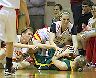 Marion's Allison Scott (2) and Alyssa Jones (32) try to strip the ball away from Beckman's Bridget Hogan (3) during their game at Marion High School, 675 South 15th Street, in Marion, on Tuesday evening, November 22, 2011. (Stephen Mally/Freelance)