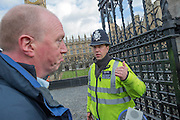 Led by Matt Wrack (here told to move on by Police at the gate), The Fire Brigades Union holds a protest rally and march.  Stating at Methodist Central Hall and then heading for Parliament. They are demanding a farer pension settlement and a rethink of the increased retirement age. They accuse Penny Mordaunt, the minister responsible, of lieing to them about the changes and their impact. Westminster London, UK 25 Feb 2015.