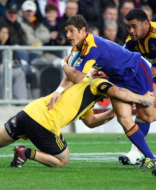 Highlander's Phil Burleigh looks to break through the Hurricanes defense  in the Super 15 rugby match, Forsyth Barr Stadium, Dunedin, New Zealand, Saturday, May 12, 2012. Credit:SNPA / Dianne Manson