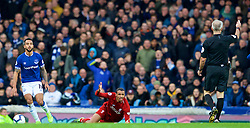 LIVERPOOL, ENGLAND - Sunday, March 3, 2019: Liverpool's Joel Matip appeals for a free-kick after being fouled by Everton's Theo Walcott during the FA Premier League match between Everton FC and Liverpool FC, the 233rd Merseyside Derby, at Goodison Park. (Pic by Paul Greenwood/Propaganda)