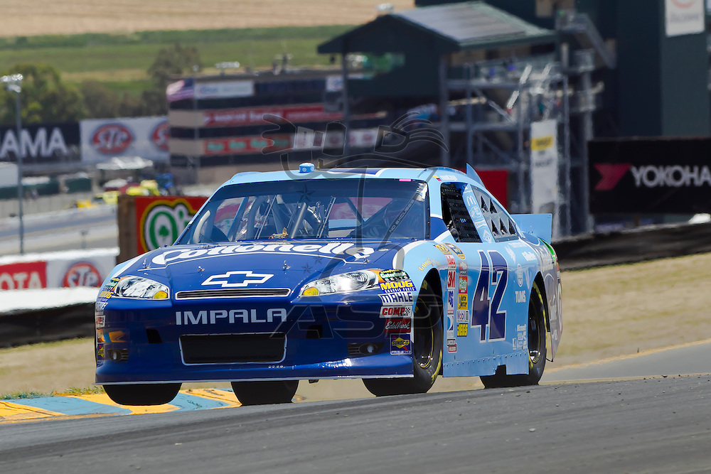 Sonoma, CA - June 24, 2011:  Juan Pablo Montoya (42) brings his race car through the turns during a practice session for the Toyota/Save Mart 350 race at the Infineon Raceway in Sonoma, CA.