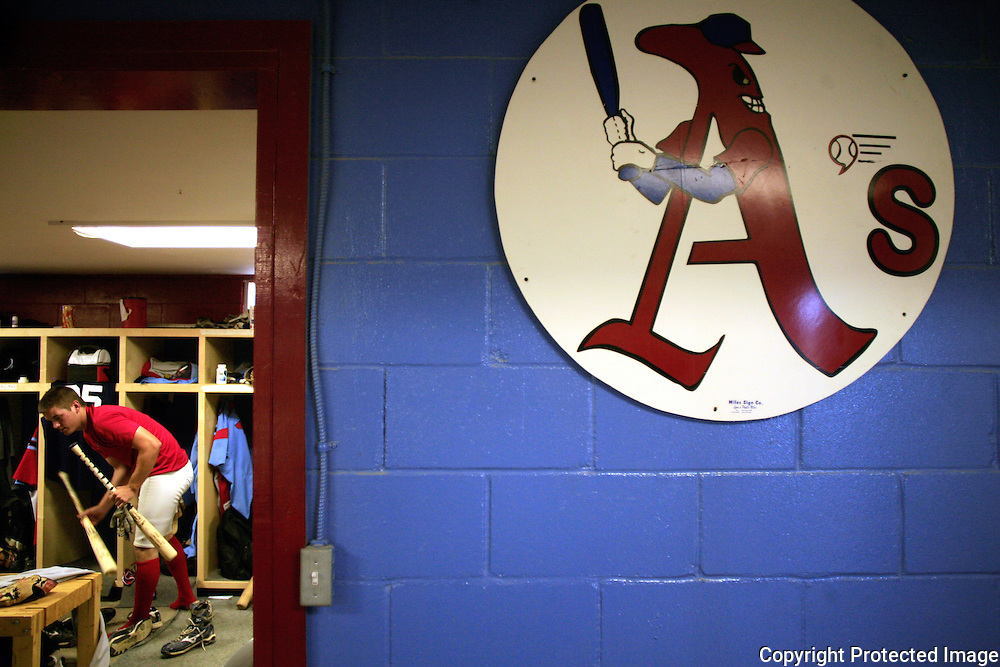 A Clarinda A's player gets ready for a game in the team's locker room.  photo by David Peterson