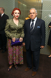 MR & MRS PANAGIOTIS LEMOS the wealthy Greek social figure at a party to celebrate the publication of 'The Russian House' by Ella Krasner held at De Beers, 50 Old Bond Street, London W1 on 9th June 2005.<br />