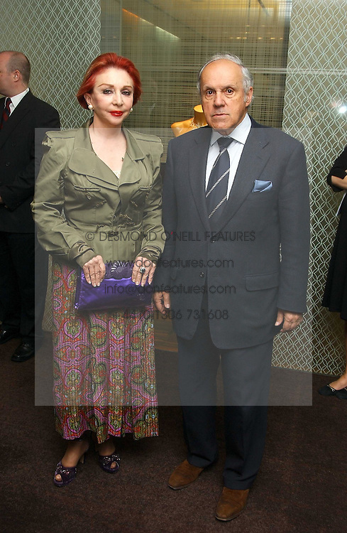 MR &amp; MRS PANAGIOTIS LEMOS the wealthy Greek social figure at a party to celebrate the publication of 'The Russian House' by Ella Krasner held at De Beers, 50 Old Bond Street, London W1 on 9th June 2005.<br />