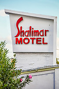 Pylon-mounted sign on the Miami  Modern style Shalimar Motel, designed by architect Edwin Reeder in 1951