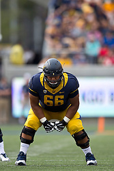 BERKELEY, CA - SEPTEMBER 12:  Offensive lineman Chris Borrayo #66 of the California Golden Bears lines up for a play against the San Diego State Aztecs during the third quarter at California Memorial Stadium on September 12, 2015 in Berkeley, California. The California Golden Bears defeated the San Diego State Aztecs 35-7. (Photo by Jason O. Watson/Getty Images) *** Local Caption *** Chris Borrayo