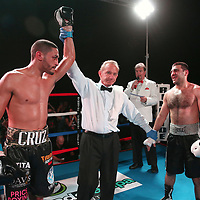Miguel Cruz of Puerto Rico celebrates his victory over Ali Mammadov of Azerbaijan during the Puerto Rico vs The World boxing event at Orlando Live Events Center on Friday, March 24, 2017 in Casselberry, Florida.  (Alex Menendez via AP)