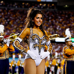 November 3, 2012; Baton Rouge, LA, USA;  A LSU Tigers Golden Girls dancer performs with the Tiger Band before a game against the Alabama Crimson Tide at Tiger Stadium. Alabama defeated LSU 21-17. Mandatory Credit: Derick E. Hingle-US PRESSWIRE