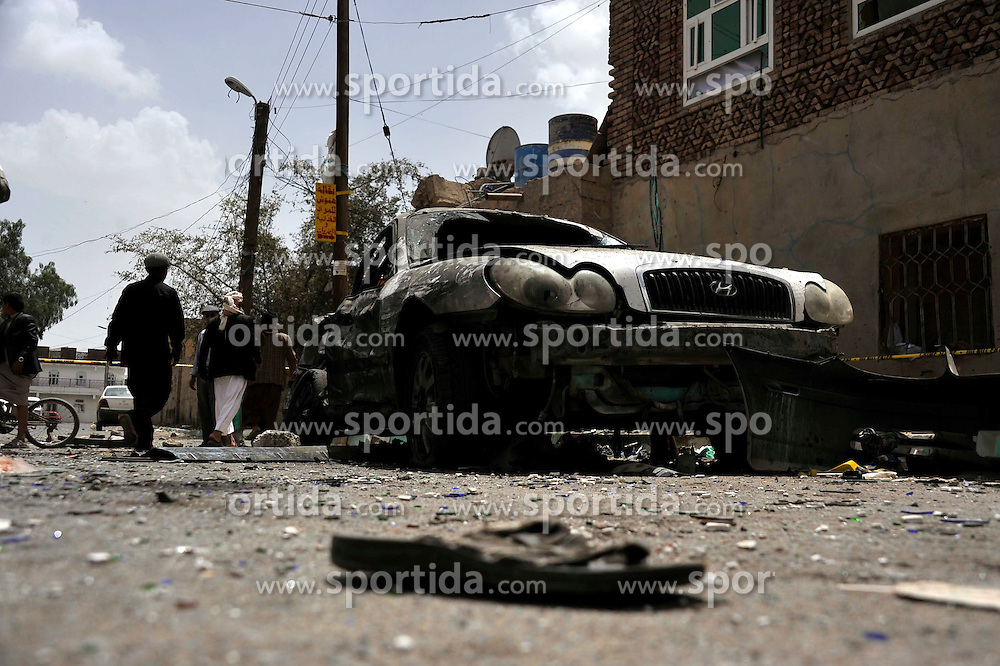 A damaged car and a shoe of a victim left on the ground are seen in Sanaa, Yemen, on March 21, 2015. The Islamic State (IS) carried out a series of suicide bombing attacks in Sanaa and the northern Saada province that have killed at least 154 people and wounded 350 others. EXPA Pictures &copy; 2015, PhotoCredit: EXPA/ Photoshot/ Hani Ali<br /> <br /> *****ATTENTION - for AUT, SLO, CRO, SRB, BIH, MAZ only*****