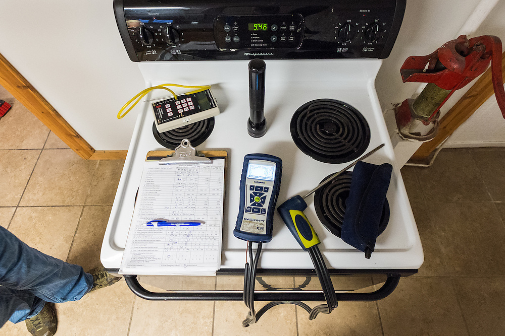 Some of Mike Lehman's tools rest atop the electric range in the basement apartment of 86 West State Street during an energy audit Wednesday, June 24, 2015.  Photo by Ohio University  /  Rob Hardin
