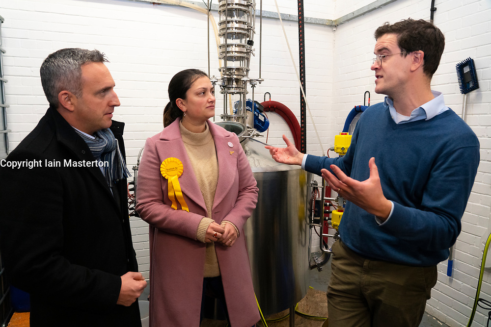 Leith, Scotland, UK. 25th November 2019. Scottish Liberal Democrat campaign chair Alex Cole-Hamilton and Rebecca Bell Liberal parliamentary candidate for Dunfermline and West Fife visited Port of Leith Distillery and outlined the party's plans to target new ground such as Edinburgh North and Leith, as well as recapturing the party's traditional Scottish heartlands in the snap general election. Pictured. Ian Stirling of Leith Distillery explains distillation process. Iain Masterton/Alamy Live News.