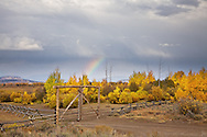 Autumn thunderstorm an rainbow in Jackson Hole Wyoming<br />