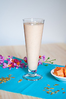 A healthy and delicious papaya-lime smoothie on a white background.