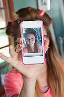 Girl taking self-portrait with cell phone