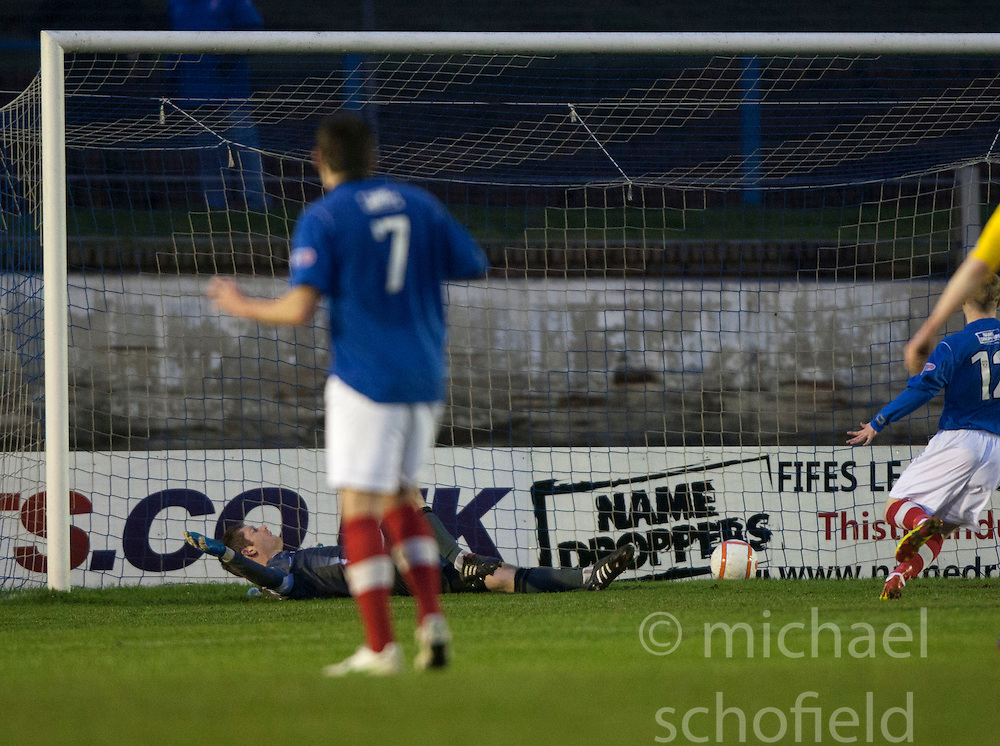 Cowdenbeath's Jamie Stevenson (7) scoring their fourth goal from a free kick past Falkirk's keeper Michael McGovern..Cowdenbeath 4 v 1 Falkirk, 9/2/2013..©Michael Schofield.