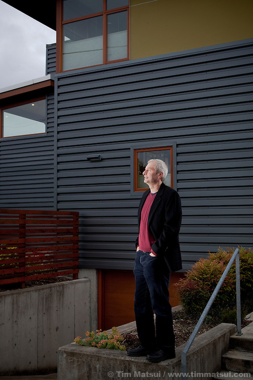 Architect Rick Mohler outside the home he designed in Seattle which took advantage of a city code, enabling him to build two residential homes on a single lot, thus increasing the urban density.