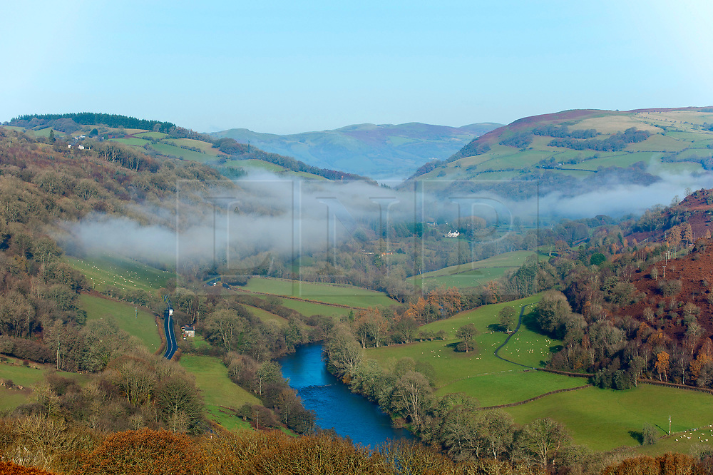 © Licensed to London News Pictures. 29/11/2019. Erwood, Powys, Wales, UK. Mist hangs over the Wye Valley near Erwood in Powys, Wales, UK after temperatures plummeted to several degrees C below freezing in Powys last night. Photo credit: Graham M. Lawrence/LNP